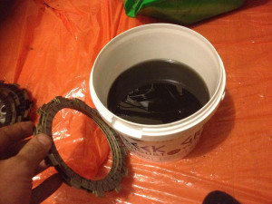 Preparing to soak new friction plates in old oil